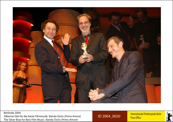Banda Osiris   Prizes, Honours & Juries | 2. Silver Bears  The Silver Bear for Best Film Music: Banda Osiris (Primo Amore | First Love)  ID 2004_0020