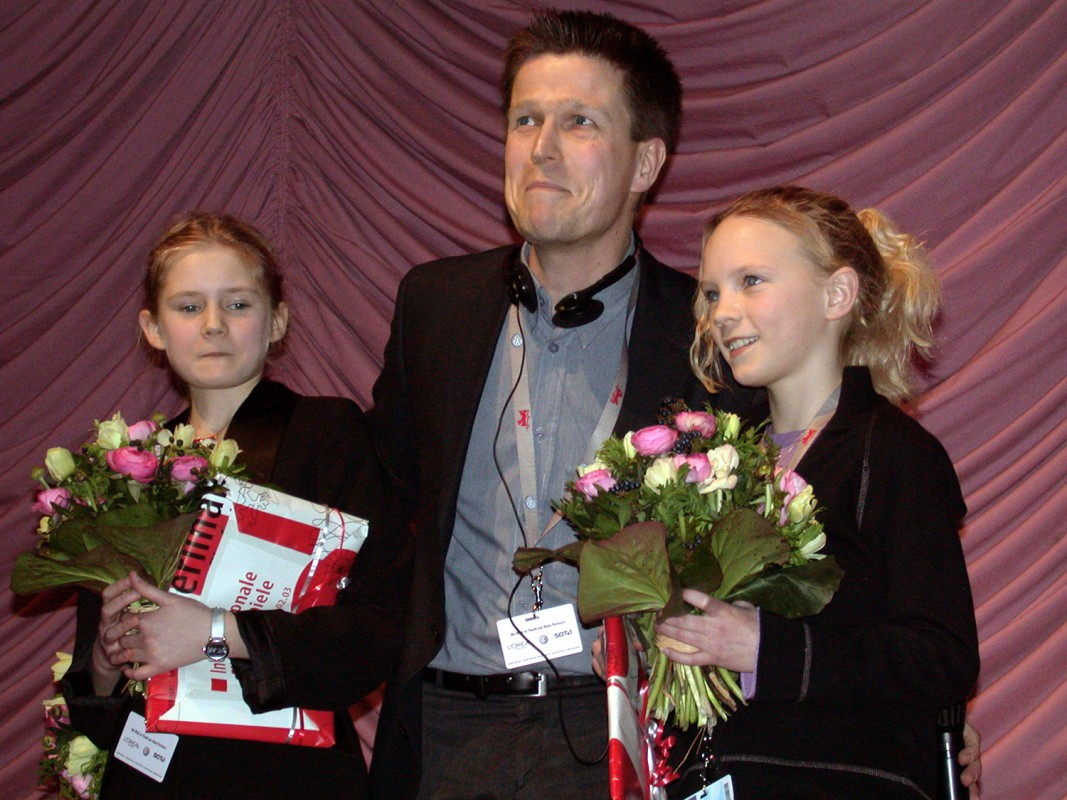 Klaus Härö and his leading actors   Director Klaus Härö and his leading actors receive a standing ovation at the premiere of their film  Elina  (from left to right) Natalie Minnevik, Klaus Härö, Tind Soneby     Generation  –   Elina – Som om jag inte fanns  | Elina     Feb 9, 2003
