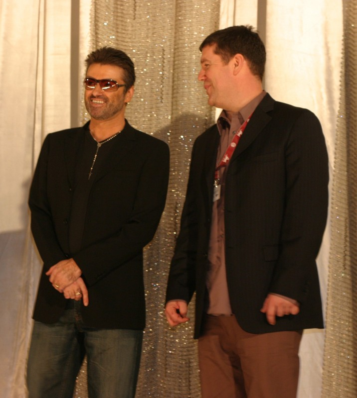 George Michael and director Southan Morris after the screening on the stage of Kino International.     Panorama  –   George Michael – A Different Story      Feb 16, 2005