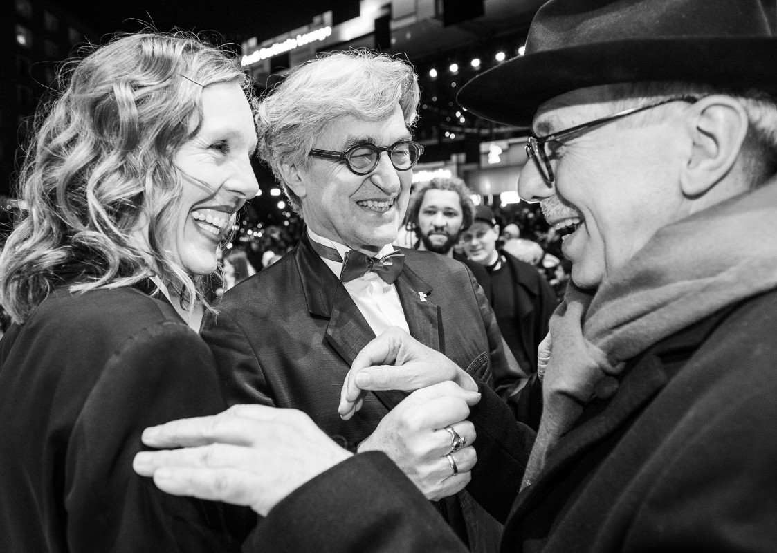 Donata Wenders, Wim Wenders, Dieter Kosslick   The photographer Donata Wenders and her husband, the director Wim Wenders, are warmly greeted by Dieter Kosslick on the Red Carpet.    Opening Gala    Feb 7, 2019