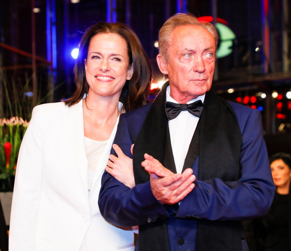 Claudia Michelsen, Udo Kier   The actress together with Udo Kier, who is featuring in two productions at this year's Berlinale.     Panorama  –   La fiera y la fiesta  | Holy Beasts  – Opening Gala    Feb 7, 2019