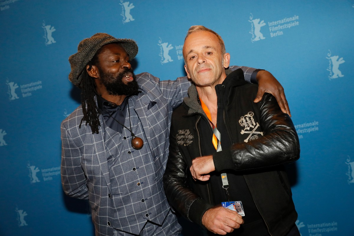 Freddy Tsimba, Renaud Barret   The Congolese artist and the director of the film.     Panorama  –   Système K  | System K     Feb 8, 2019