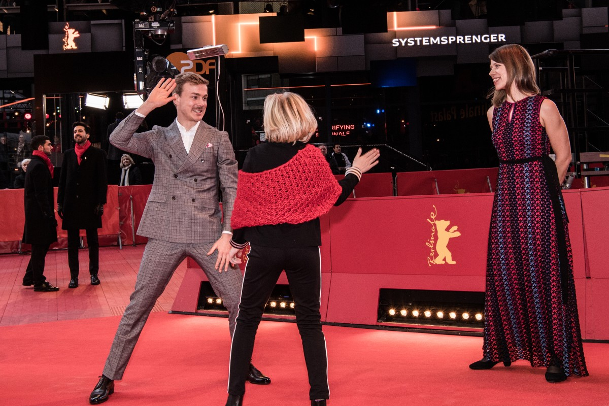Albrecht Schuch, Helena Zengel, Nora Fingscheidt   The director with her actors on the Red Carpet.     Competition  –   Systemsprenger  | System Crasher     Feb 8, 2019