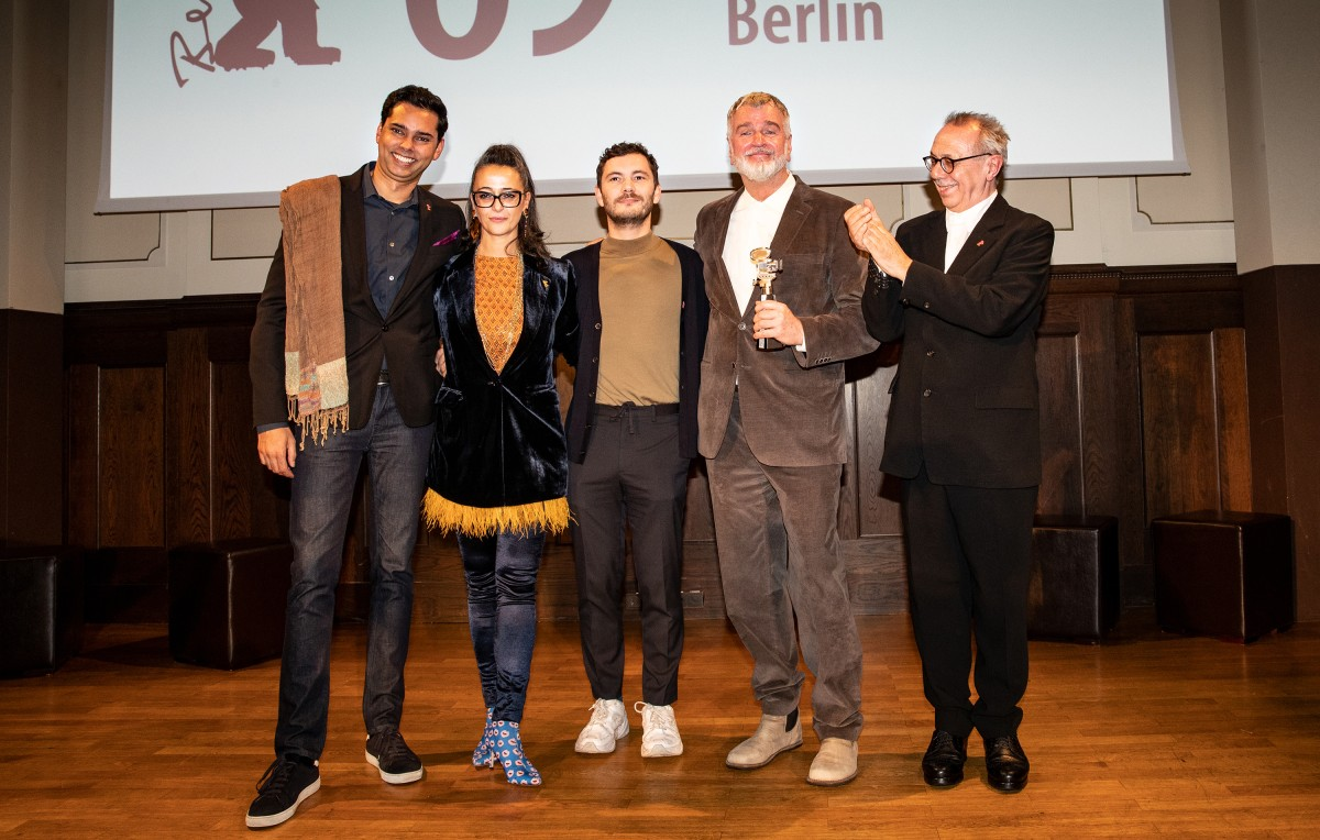 Rajendra Roy, Paz Lázaro, Michael Stütz, Wieland Speck, Dieter Kosslick   The laudator, the section head and the curator and programme manager of  Panorama , the awardee, and the Festival Director.    Berlinale Camera    Feb 10, 2019