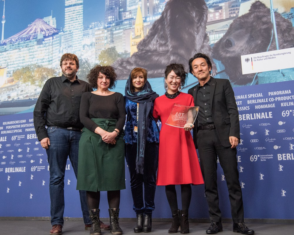 "Group picture   The Jury of the CICAE (""Confédération Internationale des Cinémas D´Art et Essai"") Art Cinema Award in the section  Panorama  - Matthias Damm, Tanja Helm and Elaheh Godarzi - with the winners, the director HIKARI and the producer Shin Yamaguchi.     Panorama  –   37 Seconds   – Prizes of the Independent Juries    Feb 16, 2019"