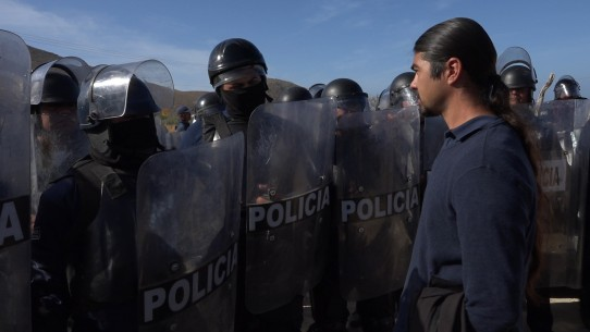 Patrimonio   Culinary Cinema  USA 2017  by: Lisa F. Jackson, Sarah Teale John Moreno, the fishermen's attorney, confronts state riot police as they break the fishermen's blockade of the mega development's construction © Lisa F. Jackson